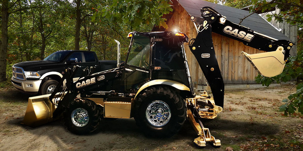 The Ram 3500 Laramie Longhorn Crew Cab 4x4 and matching Case 580 Super N Wide Track Backhoe.