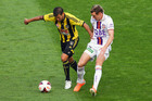 Vince Lia of the Phoenix and Shane Smeltz of the Glory compete for the ball during the round 22 A-League match between Wellington Phoenix and Perth Glory. Photo / Getty Images.