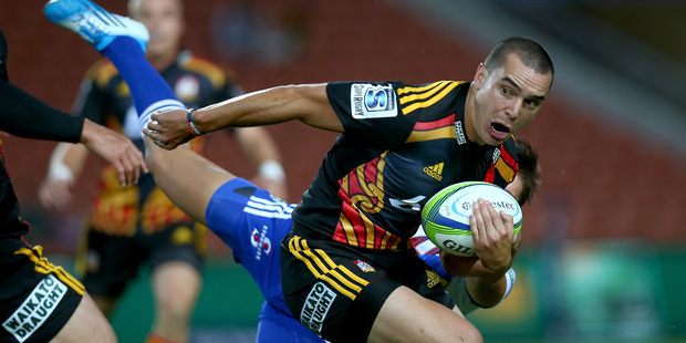 ames Lowe of the Chiefs is tackled by Jacobus Petrus Van Wyk of the Stormers during the round five Super Rugby match between the Chiefs and the Stormers. Photo / Getty Images.