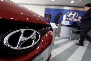 The logo of Hyundai Motor Co. is seen on a car at the automaker's showroom in Seoul, South Korea, Hybrid cars from the Korean manufacturer are boosting car sales. Photo / AP