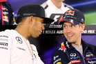 Lewis Hamilton and Sebastian Vettel will fight it out in tomorrow's race at Albert Park, Melbourne. Photo / AP