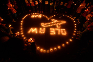 A candlelight vigil for passengers on the missing Malaysia Airlines Flight 370. Photo / AP