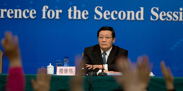 In a key speech Finance Minister Lou Jiwei announced the economic growth target will stay at 7.5 per cent this year. Photo / AP