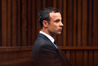 Oscar Pistorius, listens to cross questioning in court. Photo / AP