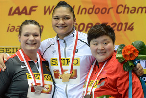 New Zealand's gold medal winner Valerie Adams hugs Germany's silver medal winner Christina Schwanitz, left, and China's bronze medal winner Gong Lijiao. Photo / AP
