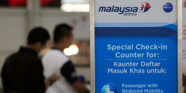 Passengers check in at a Malaysia Airlines counter at Kuala Lumpur International Airport in Sepang. Photo / Getty Images
