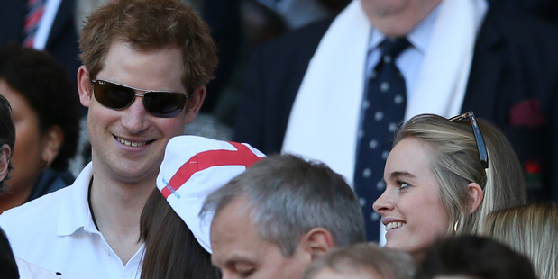 Britain's Prince Harry, left, with his girlfriend Cressida Bonas attend the Six Nations Rugby Union match. Photo / AP
