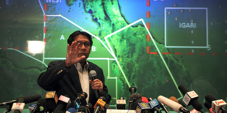 Malaysia's Department of Civil Aviation's Director General Azharuddin Abdul Rahman briefs reporters on search and recovery efforts within existing and new areas. Photo / AP