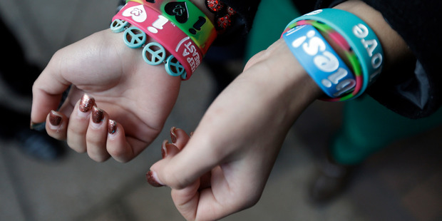 Easton Area School District student Kayla Martinez, 14, displays her bracelets for photographers outside the US Courthouse in Philadelphia. Photo / AP