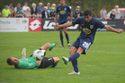 Auckland's Emiliano Tade kicks for goal. Waitakere United vs Auckland City FC, ASB Premiership semi-final first leg, Fred Taylor Park, Whenuapai, Auckland. Photo / Jason Dorday.