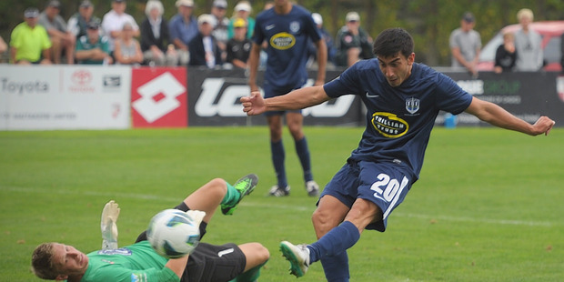 Auckland's Emiliano Tade kicks for goal. Waitakere United vs Auckland City FC, ASB Premiership semi-final first leg, Fred Taylor Park, Whenuapai, Auckland. Photo / Jason Dorday.