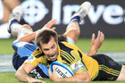 Hurricanes captain Conrad Smith scores a winning try. Photo / Greg Bowker