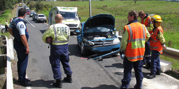 Emergency services at the scene of today's crash on a one-lane bridge near Kerikeri.