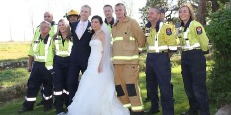 Volunteer fire crew, mainly from Featherston fire station, surround Wellington newlyweds Tom Knobloch and Micaela Yee at the Brackenridge Country Retreat and Spa. Photo/Andrew Bonallack
