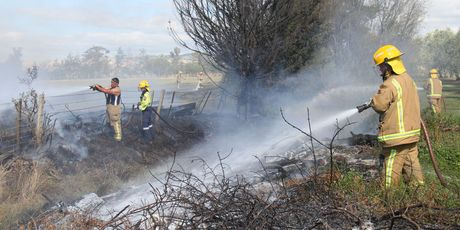 Fire crews from Martinborough, Carterton and Featherston damp down a scrub fire on the boundary of Brackenridge Resort and Spa on White Rock Rd near Martinborough, while a wedding was taking place.
