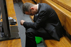 Oscar Pistorius sits in the dock with his head bowed in court in Pretoria. Photo / AP