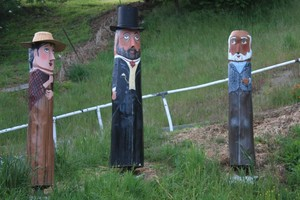 Wooden statues commemorate the first discovery of gold in the area. Photo / Paul Rush