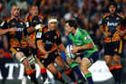 Ben Smith of the Highlanders makes a run at Rhys Marshall of the Chiefs. Photo / Getty Images