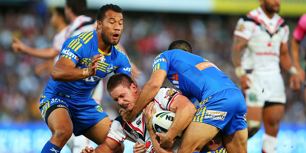 Jacob Lillyman of the Warriors is tackled by the Eels defence during the match against the Parramatta Eels. Photo / Getty Images