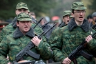 Volunteers in a pro-Russian armed force are sworn in at Simferopol in Ukraine. Photo / AP