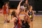 Louise Thayer of the Tactix defends Jo Harten (right) of the Magic. Photo / Getty Images