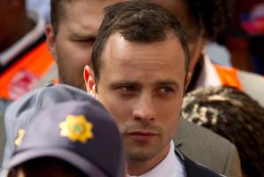 Oscar Pistorius leaves the high court in Pretoria. Photo / AP