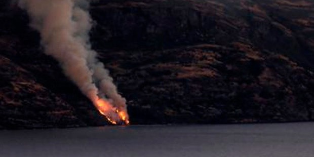 Flames seen up the incline of the isolated Cecil Peak from Steamer Wharf in Queenstown . Photo / Craig Robertson