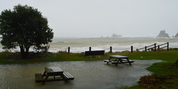 The Storm Surge coming over the banks and onto the roads in the Bay of Islands. Photo / Rita & Geoff Baker