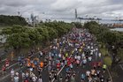 People take part in the 8.4km Round the Bays fun run. Photo: Brett Phibbs