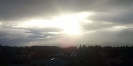 The view of the distant rain from Rotorua's Selwyn Heights. Photo sent in by Roxy Mills.