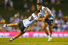 Albert Kelly of the Titans runs the ball during the round one NRL match between the Cronulla Sharks and the Titans. Photo / Getty Images
