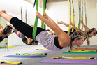 Aerial yoga requires strength and balance. Photo / Bruce Simons