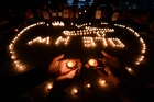 Students in Yangzhou, China, hold a vigil for those on the missing Malaysia Airlines flight. Photo / AP