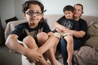 Roman Daniell (left), who needed oral surgery, with his mother, Jenny, and brother, Silas. Photo / Greg Bowker