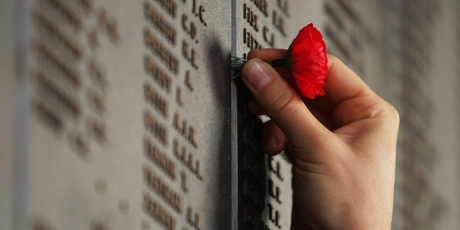 Red paper poppies inserted next to many names on the Roll of Honour show the significance for visitors.