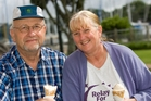 Ray Taylor and Evonne Bingley enjoy ice cream at the Town Basin after the storm. Photo/Ron Burgin