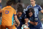 Liaki Moli (L) and Steven Luatua on the charge for the Blues last night at Eden Park. Photo / Getty Images