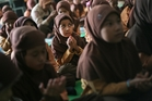 Students pray for the passengers aboard the missing Malaysia Airlines flight MH370  at a school in Medan, North Sumatra, Indonesia. Photo / AP