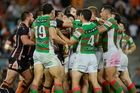 Tigers and Souths players get up close and personal. Photo / Getty Images