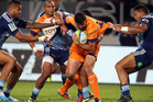 Hennie Daniller of the Cheetahs is caught by Frank Halai (L) and George Moala of the Blues during the round six Super Rugby match between the Blues and the Cheetahs. Photo / Getty Images.