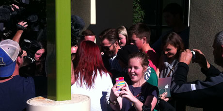 Chris Pine (sporting sunglasses and beard) is surrounded by autograph hunters. Photo / Ashburton Guardian