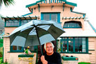 Former television personality Olly Ohlson keeps dry outside his new Otago Peninsula home yesterday. Photo / Gerard O'Brien ODT