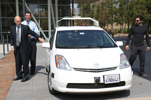 California Gov. Jerry Brown, California State Sen. Alex Padilla and Google co-founder Sergey Brin exit a self-driving car at the Google headquarters. Photo / AP