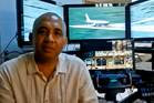 Zaharie Ahmad Shah the pilot of missing Flight MH370 in a YouTube video in front of his home-built flight simulator. Photo / AP