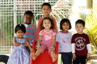 KiNZ Myers Park students, from left, Chetana Chincholimath, Nyatefe Kumah, Iakapo Asiata, Mahina Tromp  (on slide), Vedaanshi Anand and Peerapat Chingsrithong. Photo /  Chris Gorman