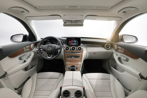 The interior of the Mercedes-Benz C-Class is refined with five air vents and a touchscreen in the dash.