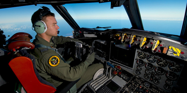 A Royal Australian Air Force pilot steers his AP-3C Orion over the Southern Indian Ocean during the search for missing Malaysian Airlines flight MH370.