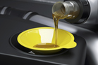 It's advisable to use a funnel when doing an oil change, to avoid messy spillage. Photo / www.jupiterimages.com
