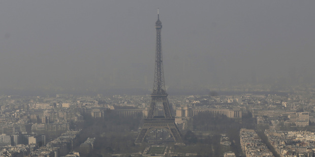 The Eiffel Tower is barely seen through the smog from Paris. Photo / AP