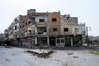 Damaged buildings are seen in Yabroud town, Syria.